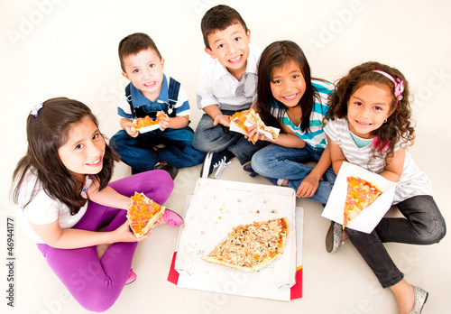 Group of kids eating pizza