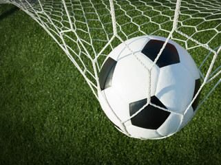 Soccer ball in goal, success concept