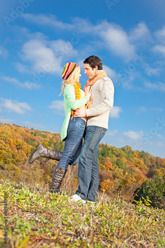 Happy young couple spending time outdoor in the park