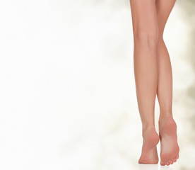 Legs of a woman against abstract background
