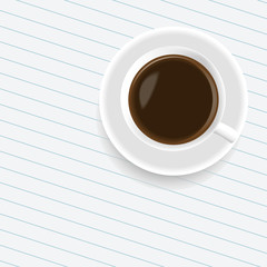 A cup of coffee on the sheet of paper