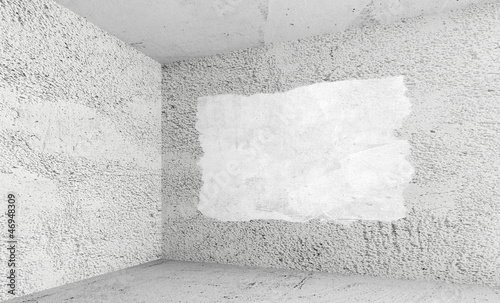 Empty room with concrete walls and white paint covering