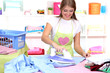Young girl ironing in room