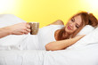 morning coffee in bed for young  woman on yellow background
