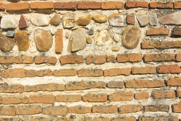 Symmetric background or texture old brick wall XV century