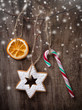 Christmas sweets hanging over wooden background