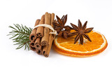 orange slice, cinnamon with fir branch isolated on white