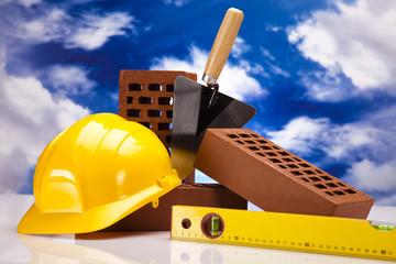 Brick, yellow hard hat, tools