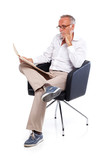 Casual senior man reading stock rates in newspaper 2