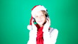 Little girl Santa listening to music