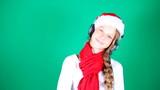 Little girl Santa listening to music