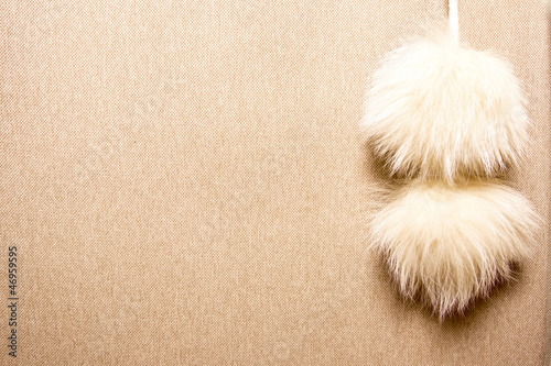 Cashmere texture with fur pompons