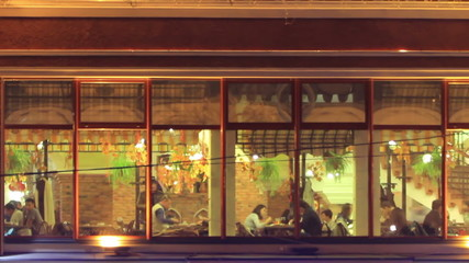 Night cafe in the city,  look through  window