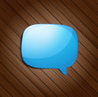 Vector glossy speech bubble on wood background