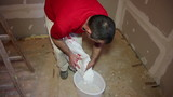 Preparing Plaster in a Bucket