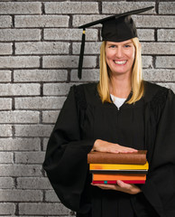 Happy Graduate Woman Holding Books