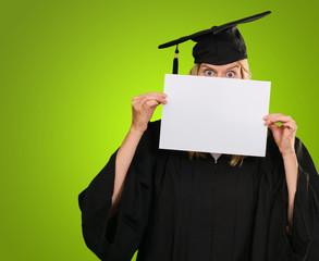 graduate woman hiding behind a blank paper