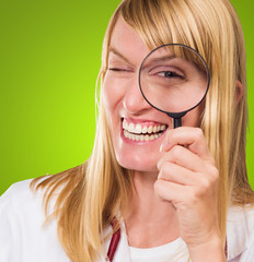 Happy Doctor Looking Through Magnifying Glass