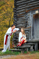 Young couple in Ukrainian style clothes flirting
