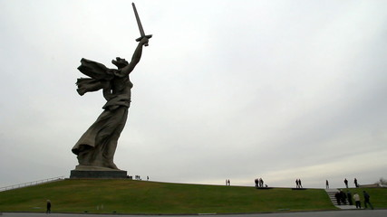 Mamaev Burial. People comes to statue of Motherland