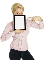 Business woman pointing at her tablet pc with copyspace