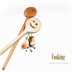 Wooden spoon with garlic and spice