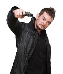 furious man pointing with a gun