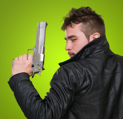 Portrait Of A Man Holding Gun