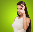 Young Woman Looking Through Imaginary Binocular