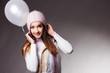 Beautiful fashion woman in studio with white balloon