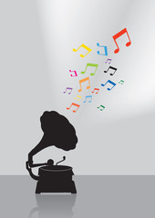 Vintage gramophone silhouette in colorful musical concept on the