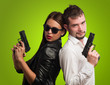Young Couple Holding Gun