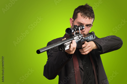 Young Man Aiming With Rifle
