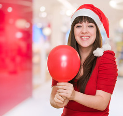 happy christmas woman holding a balloon