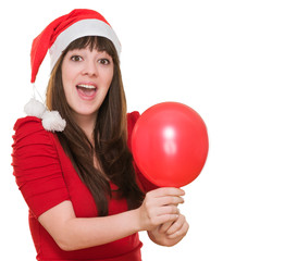 Surprised woman wearing a christmas hat and holding a balloon