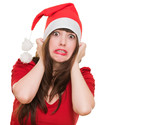 scared woman wearing a christmas hat