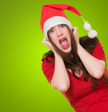 furious woman wearing a christmas hat