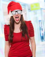 angry christmas woman with a hat and glasses covering her eyes