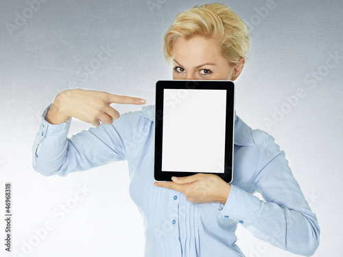 Woman pointing a finger at her tablet pc with copyspace