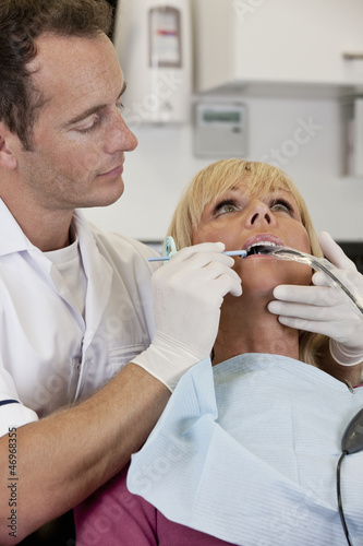 A female patient having an x-ray at the dentists
