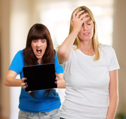 Frustrated Woman In Front Of Shocked Woman