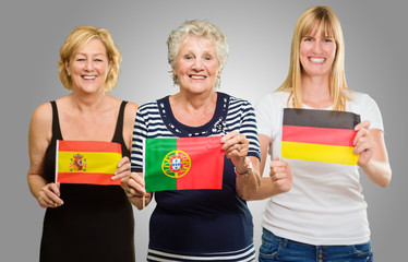 Three Woman Holding Different Flag