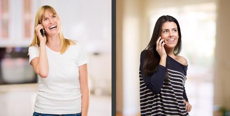 Portrait Of Happy Women Talking On Cellphone
