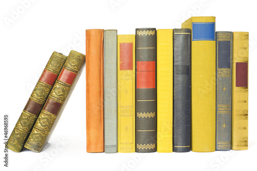 vintage books in a row, isolated on white background, blank labe