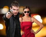 Man Aiming Through Gun