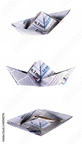 three views of a boat made with a newspaper page