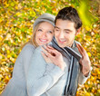 Happy couple have a romance in fall