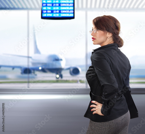 business woman in airport ll