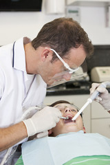 A young boy patient having dental treatment, close up