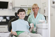 A young boy with a dental nurse/hygienist